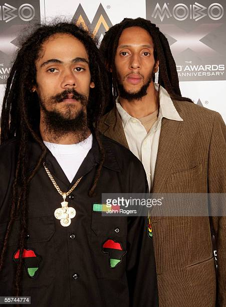 """The late Bob Marley's sons Damian """"Jr. Gong"""" Marley and Julian Marley pose backstage during the MOBO Awards 2005, the tenth anniversary of the annual..."""
