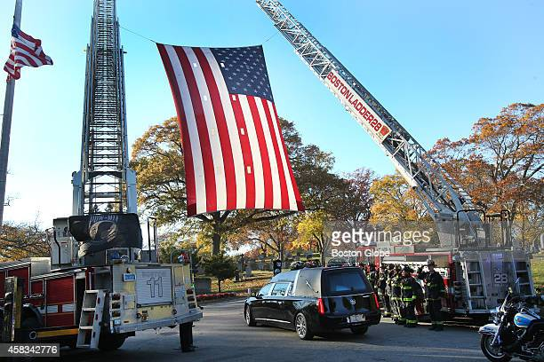 The late Boston mayor Thomas M Menino's motorcade enters Fairview Cemetery