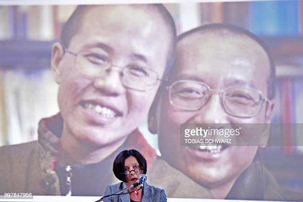 The late Chinese dissident and Nobel Peace Prize laureate Liu Xiaobo and his widow Liu Xia are seen on the screen as Nobel laureate Herta Mueller...