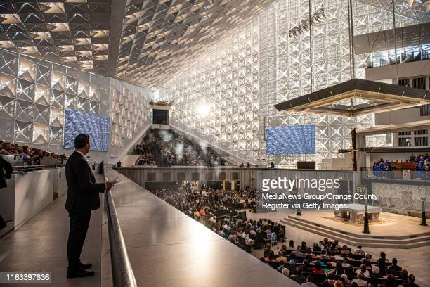 The late evening sun filters through the quatrefoils covering glass panes of Christ Cathedral as the faithful attend a Solemn Evening of Prayer in...