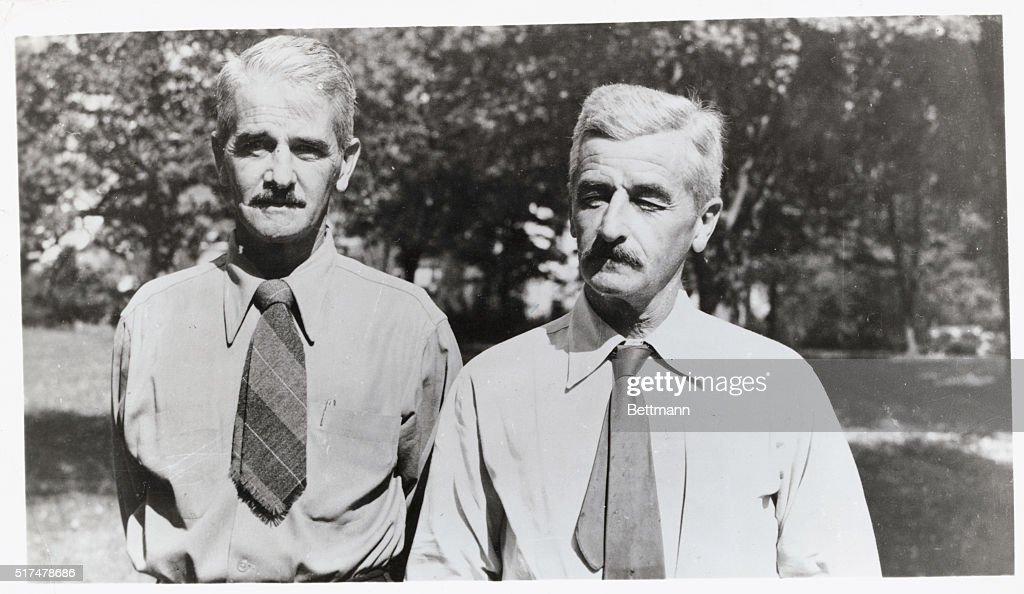William and John Faulkner Posing Together : News Photo
