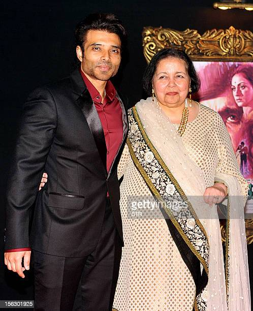 The late Indian Bollywood producer and director Yash Chopra's wife Pamela Chopra and her son film actor Uday Chopra pose on the red carpet at the...