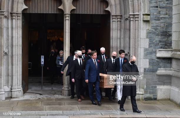 The late John Humes remains are carried from St Eugene's cathedral after the funeral of the former SDLP leader and Nobel Peace Prize winner on August...