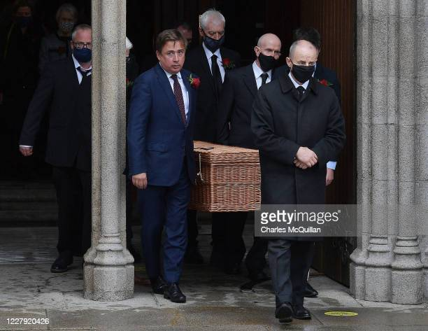 The late John Humes' remains are carried from St Eugene's cathedral after the funeral of the former SDLP leader and Nobel Peace Prize winner on...