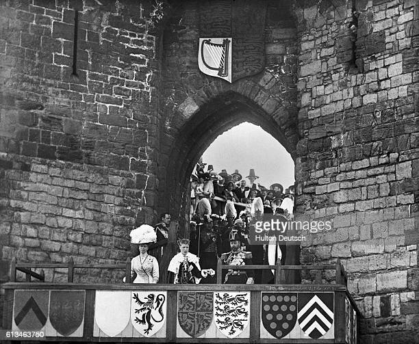 The New King Investiture 1911 The late King presenting the Prince of Wales at [] gateway Carnarvon Castle after his Investiture 1911 Acceded as...