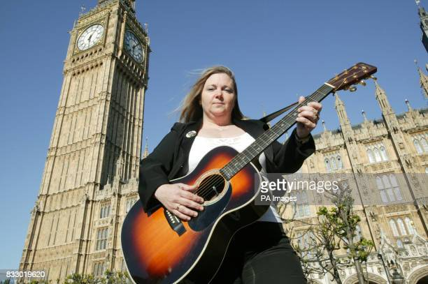 The late Lonnie Donehgan's wife Sharon Donegan with one of Lonnie's famous guitars at The Houses of Parliament