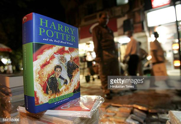 The latest hardcover issue of JKRowling's Harry Potter being sold at a street side book shop for as low as Rs700
