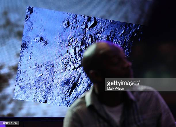 The latest image from the New Horizons spacecraft that passed with 7,800 miles of Pluto yesterday, is shown during a NASA news conference July 15,...