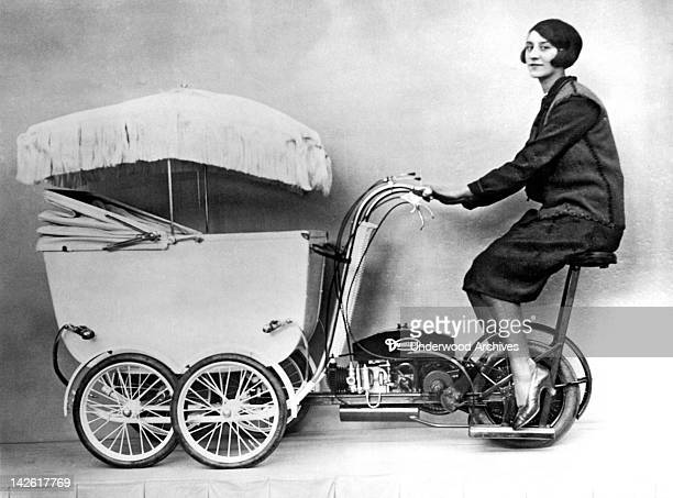 The latest invention in transportation and baby care at the British Industries Exhibition is the new fangled Pramobile with a speed of 15 mph London...