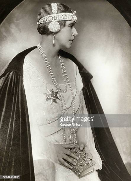 The latest portrait of Queen Marie, brought to this country by a member of her entourage, showing her majesty with bobbed hair and wearing her...