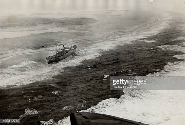 The latest victim of the treacherous sands of Sable Island long famous as the graveyard of the Atlantic the Greek freighter Alfios is seen firmly...