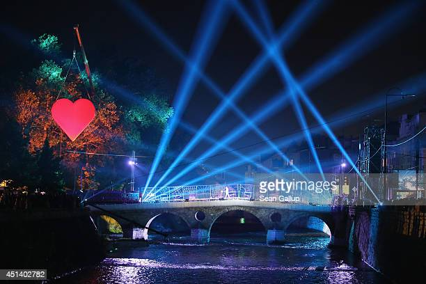 The Latin Bridge stands illuminated during a theater performance commemorating World War I near the spot where Serbian secessionist Gavrilo Princip...