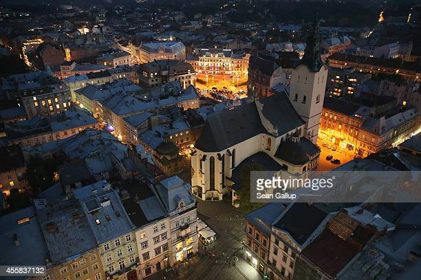 The Latin Cathedral stands in the old city center at night near Rynok Square on September 15 2014 in Lviv Ukraine Lviv which is located in western...
