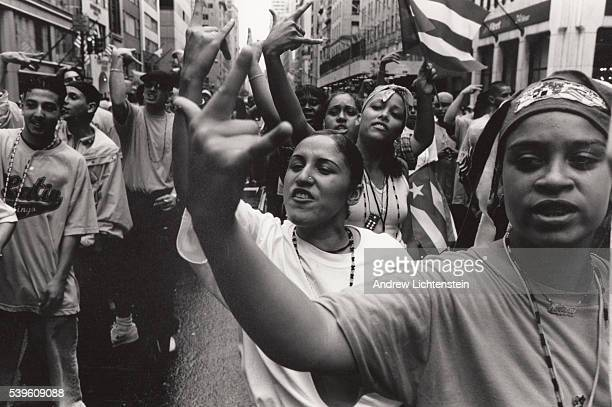 The Latin Kings and the Latin Queens a street and prison gang march up Fifith Avenue in the annual New York City Peuto Rican Day Parade