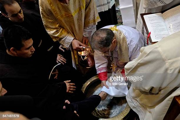 The Latin Patriarch of Jerusalem Fuad Twal and catholic clergymen perform the traditional Washing of the Feet ceremony during Holy Week rituals at...
