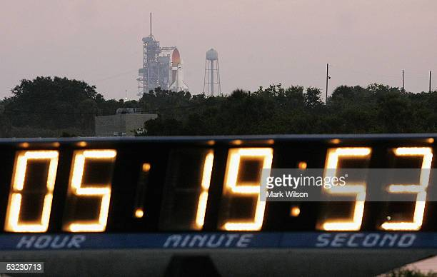 The launch clock counts down as the Space Shuttle Discovery sits on its launch pad at the Kennedy Space Center July 13 2005 in Cape Canaveral Florida...