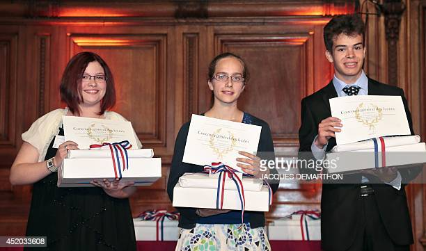 The laureates in the Latin Version category Ondine Simonot 1st prize Claire Absil 2nd prize and Antoine Ollivier 3rd prize pose with their rewards...