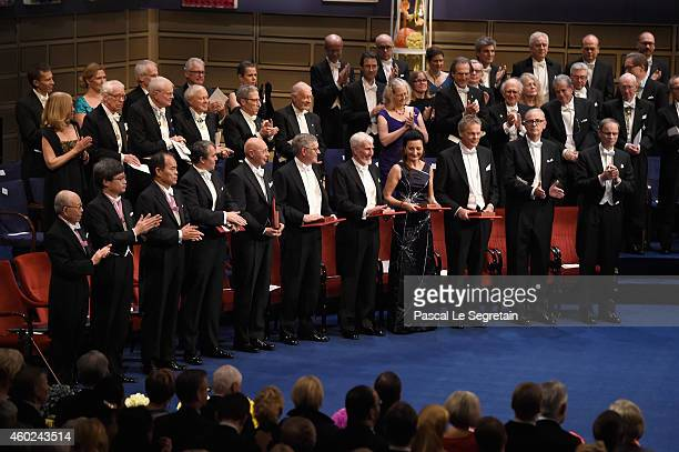 The laureates of the Nobel Prize 2014 seen on stage at the Nobel Prize Awards Ceremony at Concert Hall on December 10 2014 in Stockholm Sweden