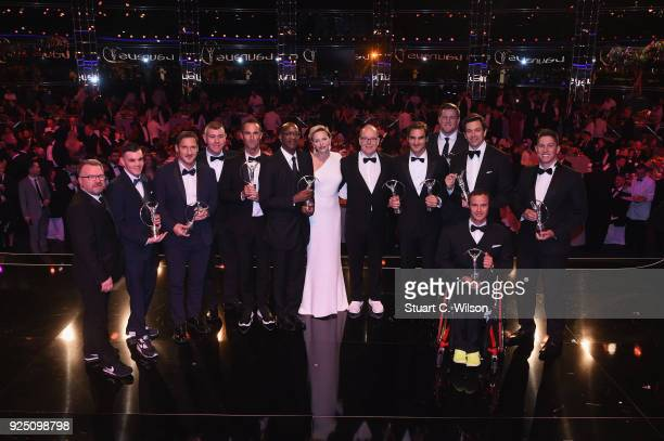 The Laureus Award winners with Prince Albert II of Monaco and his wife CharlenePrincess of Monaco pose on stage during the 2018 Laureus World Sports...
