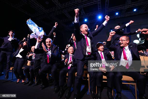 The Lausanne 2020 Delegation celebrates after they are awarded as host city for the 2020 Winter Youth Olympic Games during the Announcement Ceremony...