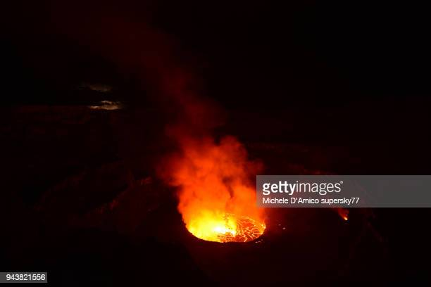 the lava lake inside the crater of nyiragongo in the night - caldera stock pictures, royalty-free photos & images