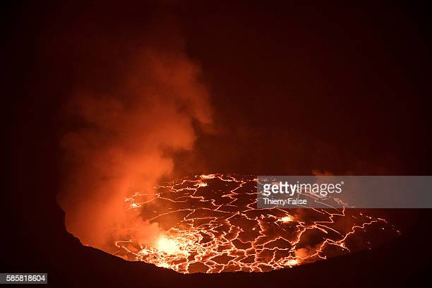 The lava lake seen from the top of the main crater of Mount Nyiragongo. The Nyiragongo is an active stratovolcano with an elevation of 3,470 metres...