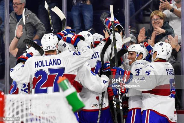 the Laval Rocket celebrate their overtime victory against the Binghamton Devils during the AHL game at Place Bell on October 13 2017 in Laval Quebec...