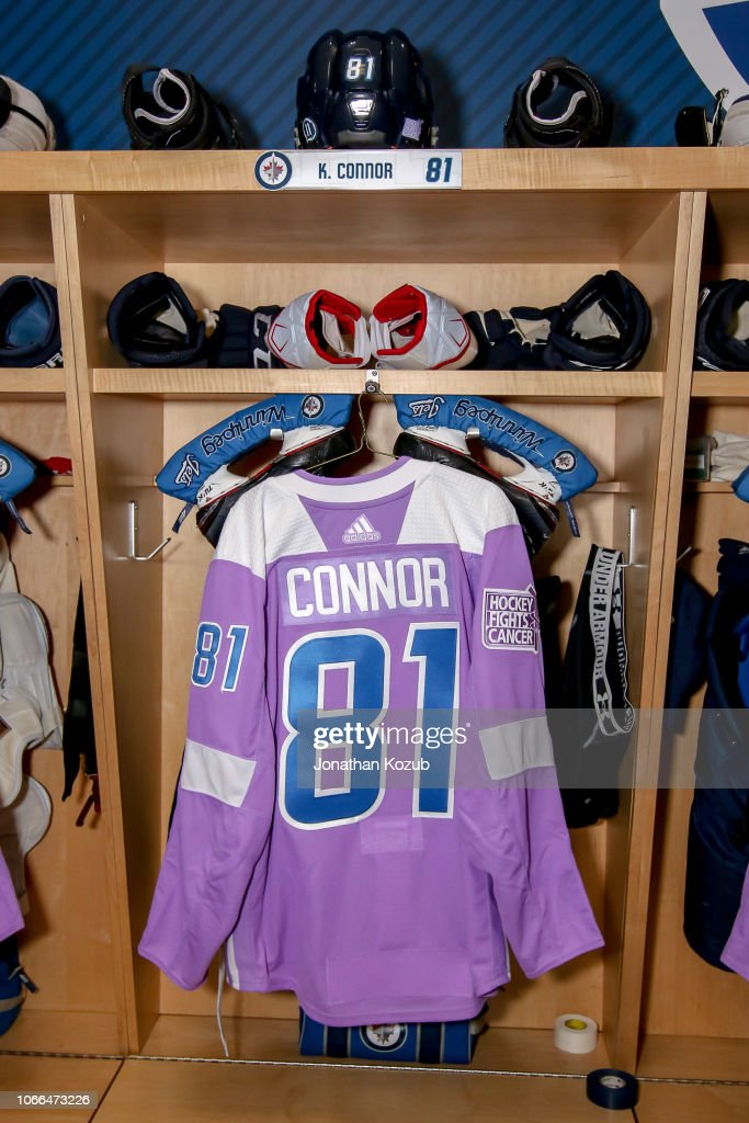 db1d50527ec The lavender jersey for Kyle Connor of the Winnipeg Jets hangs in ...