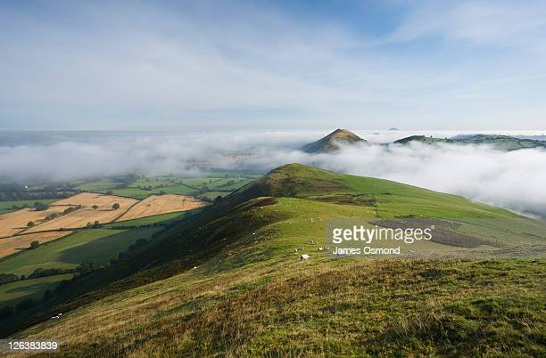 The Lawley in Mist seen from Caer Caradoc with The Wrekin in the Distance, Shropshire, England, UK