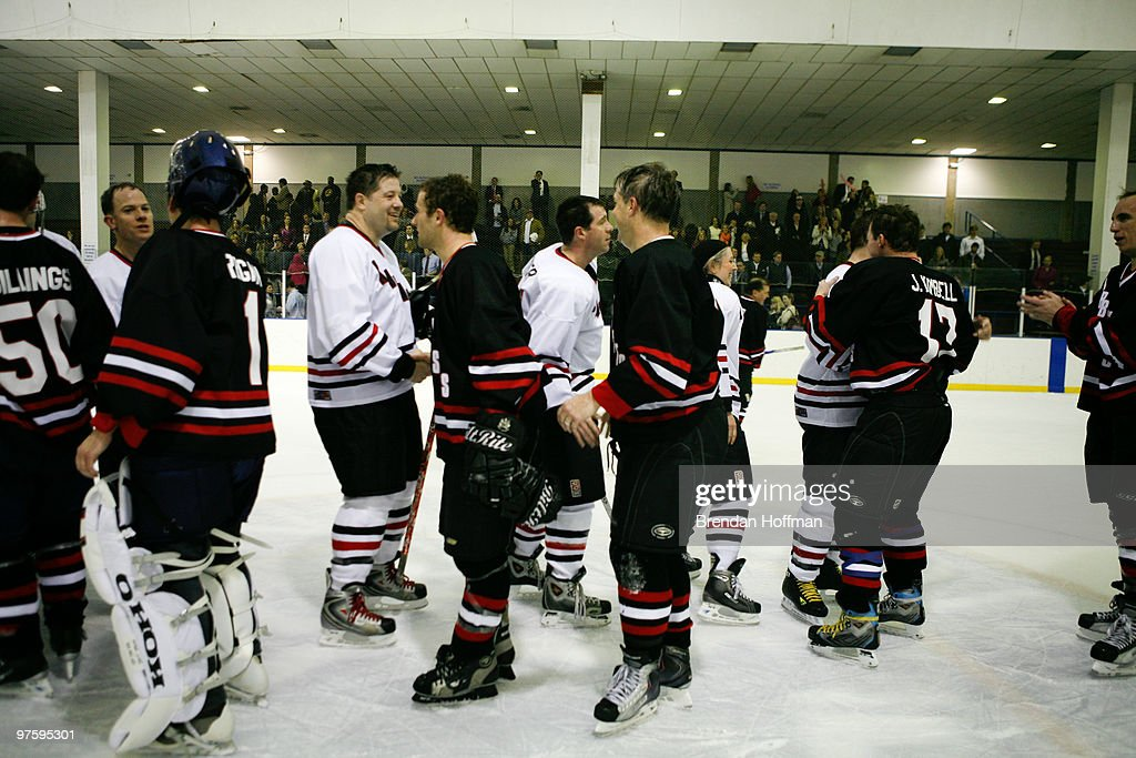 The Lawmakers and the Lobbyists shake hands after the conclusion of the Congressional Hockey Challenge, in which the Lobbyists won 7-2, on March 9, 2010 in Washington, DC. The game matches members of Congress and Congressional staff against lobbyists for major corporations as a benefit for the Fort Dupont Ice Hockey Club.