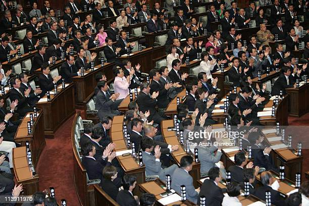 The lawmakers applaud after passing the resolution to denounce North Korea's nuclear test at the lower house on October 10 2006 in Tokyo Japan