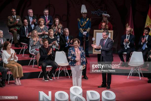 The lawyer Aurora Leon, named Son of Seville, poses during the act of delivery of the titles of Favorite Son and Medals of the City, in the Lope de...