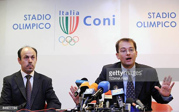 The lawyer for Spanish cyclist Alejandro Valverde Federico Cecconi speaks at a press conference with an unidentified man at the Olympic stadium in...