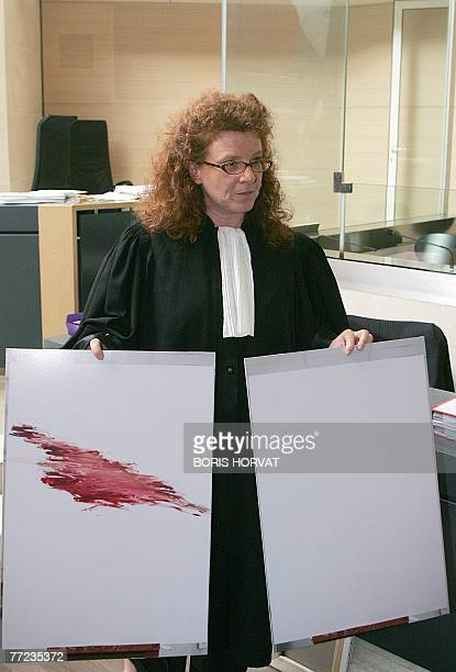 The lawyer for the plaintiffs Agnes Tricoire presents to the court a reproduction of the lipstickred kiss by Sam Rindy who vandalised a...