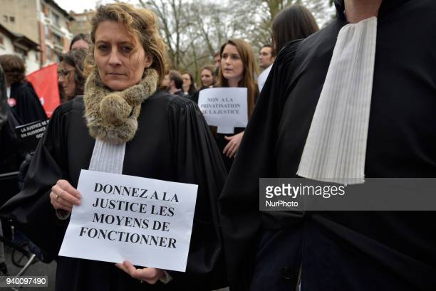 The lawyer holds a placard reading 'Give Justice the means to operate' The French Bar Association all lawyers' unions all magistrates' unions called...