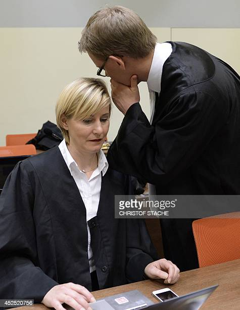The lawyers of Beate Zschaepe Anja Sturm and Wolfgang Heer speak together ahead of another session of the trial in the court room in Munich southern...