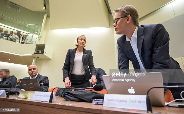 The lawyers of Codefendant Beate Zschaepe Florian Schulz Anja Sturm and Wolfgang Heer wait for the beginning of another day of the NSU neoNazi...