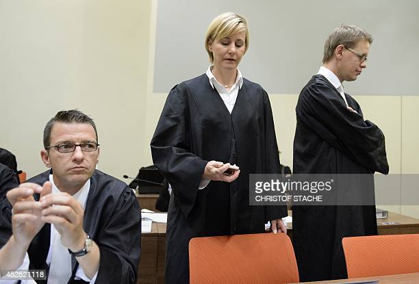 The lawyers Wolfgang Stahl Anja Sturm and Wolfgang Heer wait ahead an another session of the Beate Zschaepe trial in the court in Munich southern...