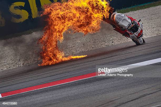 The LCR Honda bike of Australian rider Jack Miller bursts into flames at Sepang Circuit on October 24, 2015 in Kuala Lumpur, Malaysia.