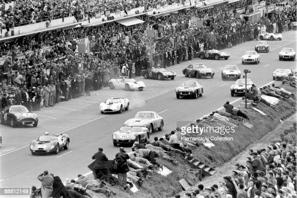 The Le Mans 24 Hours Le Mans June 1011 1961 Just after the start the cars are under way The Ferrari 250TR/61 n 10 will be the eventual winner driven...