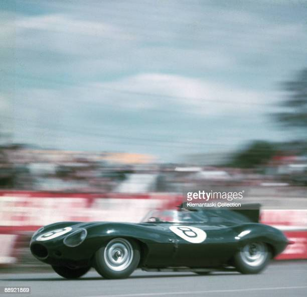 The Le Mans 24 Hours Le Mans June 1112 1955 The Jaguar Dtype of Don Beauman and Norman Dewis in Dunlop Curve Their car eventually went off the road...