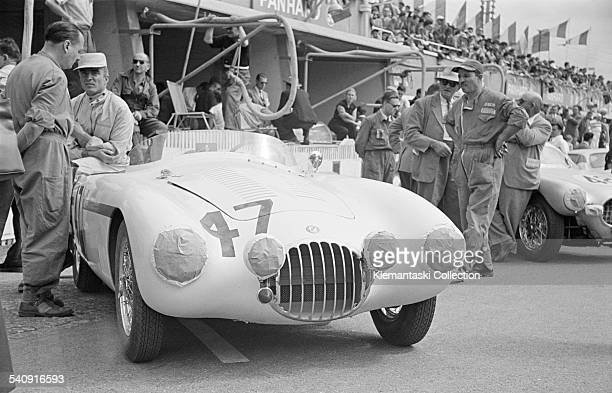 The Le Mans 24 Hours Le Mans June 1314 1953 In the pits before the start sits the lovely OSCA MT4 to be driven by Fred Wacker and Phil Hill They had...
