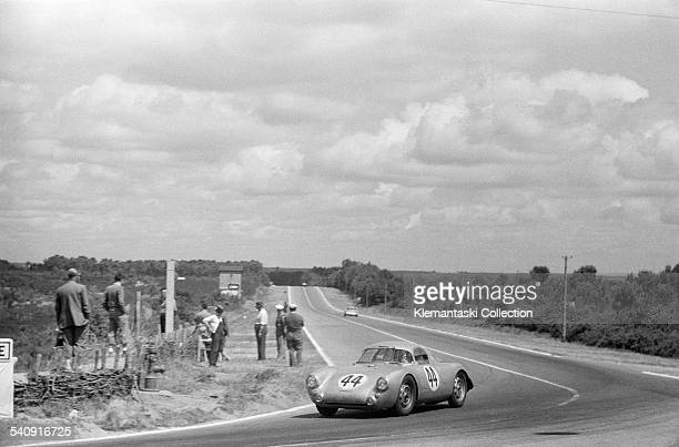 The Le Mans 24 Hours Le Mans June 1314 1953 The experimental Porsche 550 coupé which was driven by Hans Hermann and Helm Glœckler turns through...