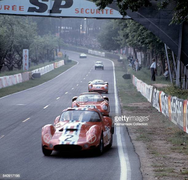 The Le Mans 24 Hours Le Mans June 1516 1963 Maserati vs Ferrari The Maserati T151 of André Simon leads the Ferrari 250Ps of JohnSurtees and Willy...