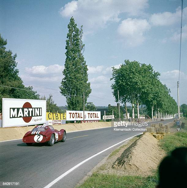 The Le Mans 24 Hours Le Mans June 1516 1963 The André Simon and Lloyd Casner Maserati T 151 roars out of Tertre Rouge onto the Mulsanne Straight A...