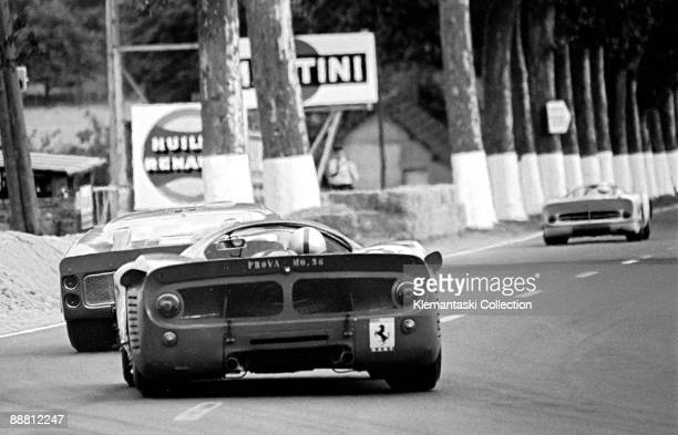 The Le Mans 24 Hours Le Mans June 1819 1966 Out onto Mulsanne go a Ferrari 365P/66 followed by a Ford GT40 and a NARTentered Ferrari 330P3