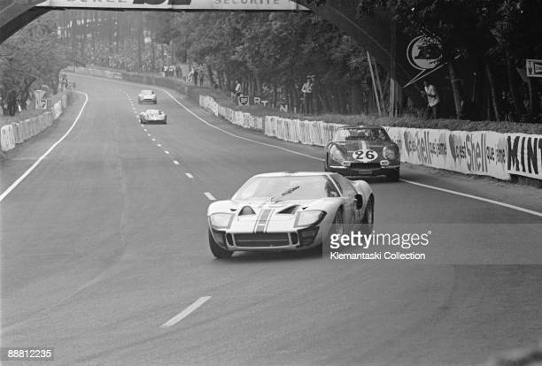 The Le Mans 24 Hours Le Mans June 1819 1966 The Ford GT40 of Guy Ligier and Bob Grossman leading the Ferrari 275GTB/C of Giampiero Biscaldi and...