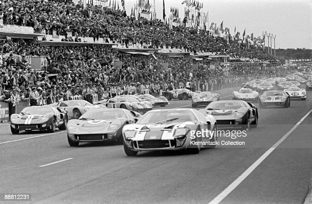 The Le Mans 24 Hours Le Mans June 1819 1966 The start of the race with the Ford GT40's in front The leading Ford is the Skip Scott/Peter Revson car...