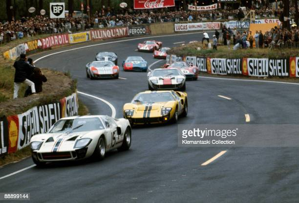 The Le Mans 24 Hours Le Mans June 1819 1966 Three Ford GT40s lead the way through the Esses early in the race The leading GT40 is the Ford France...