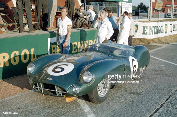 The Le Mans 24 Hours Le Mans June 2021 1959 Before the start Paul Frère the great Belgian journalistdriver stands next to the Aston Martin DBR1 with...